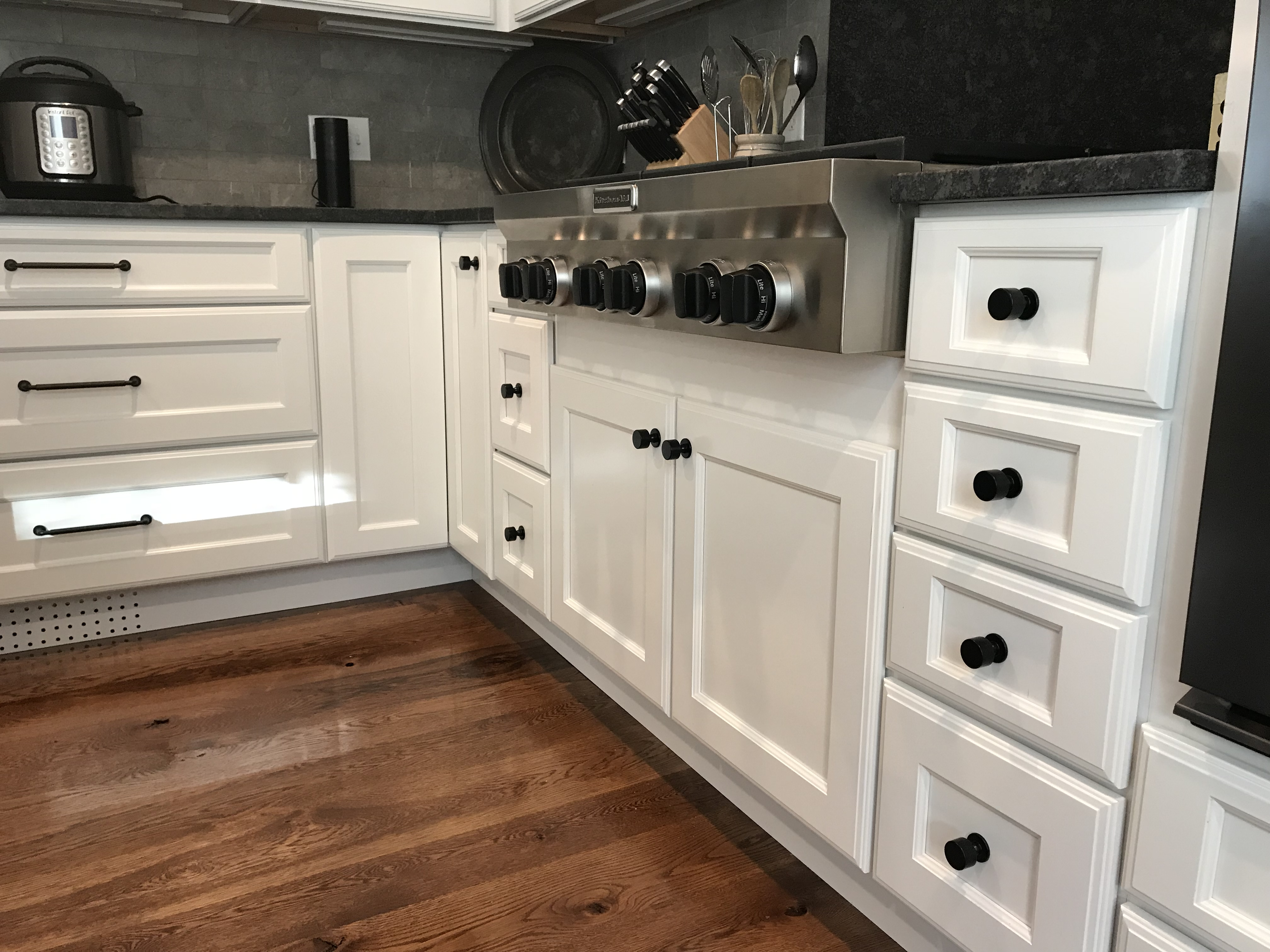 cooktop and white cabinets