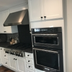 white cabinets and cooktop