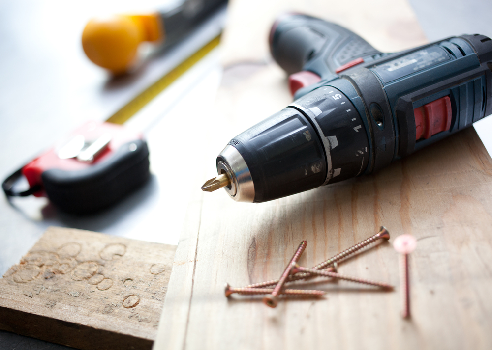 drill and measuring tape