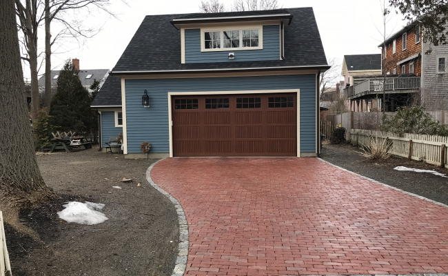 blue house with brown garage door