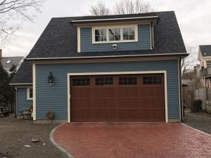 blue house with brown garage door