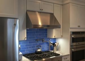 white kitchen with blue tile backsplash