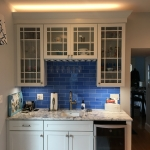 white kitchen with blue tile backsplash