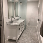 grey bathroom with double sink