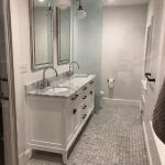 grey bathroom with double sink